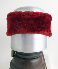 Front view of a Red Alpine Lamb Shearling Head Band against a white background