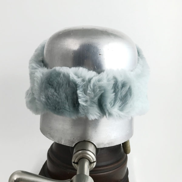 Back view of a light blue Alpine Lamb Shearling Head Band against a white background
