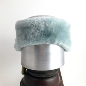 Front view of a light blue Alpine Lamb Shearling Head Band against a white background
