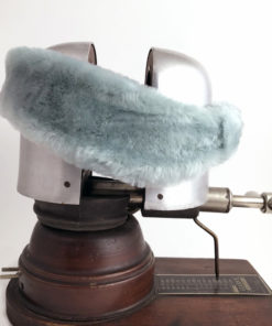 Side view of a light blue Alpine Lamb Shearling Head Band against a white background