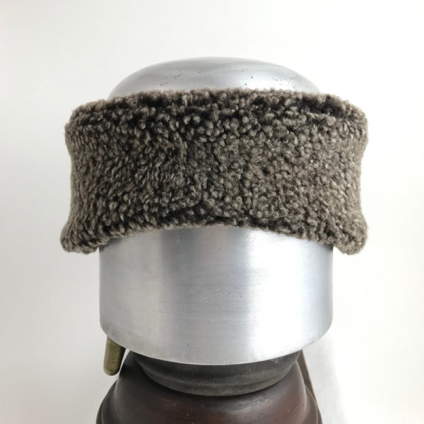 Front view of a snow top black Alpine Lamb Shearling Head Band against a white background