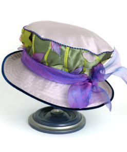 Back view of a green appliqué 100% silk Garden Tea Hat against a white background