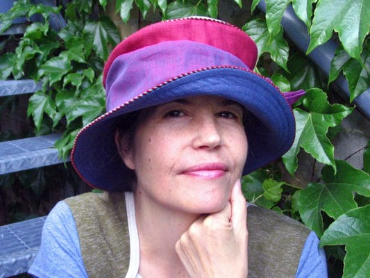 Gwendolyne wearing one of her Zinnia Linen Summer Brim hats
