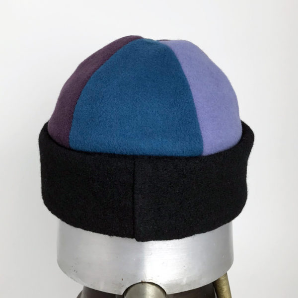Back view of a blue and mauve Bean Toque against a white background