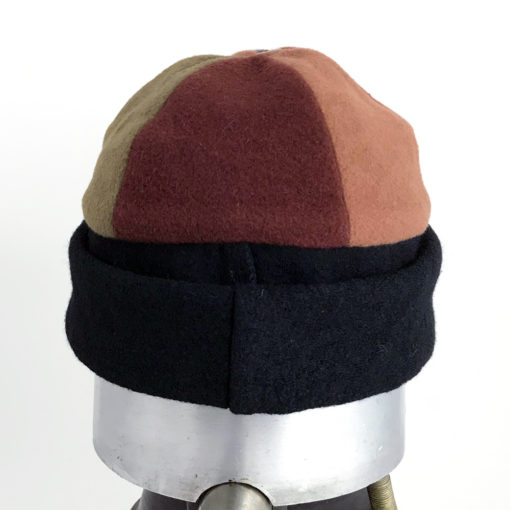 Back view of a earth tone coloured Bean Toque against a white backgroundBack view of a earth tone coloured Bean Toque against a white background