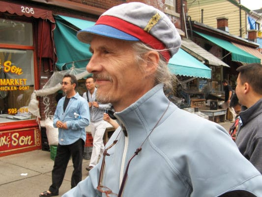 Close up of man wearing a Gwendolyne linen cap in Kensington Market