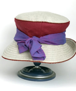 Back view of a crimson red and natural 100% linen Zinnia Summer Hat against a white background