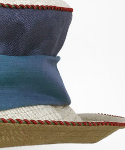 Close up view of a denim olive and natural 100% linen Zinnia Summer Hat against a white background