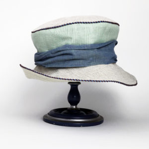 Front view of a mint green and natural 100% linen Zinnia Summer Hat against a white background