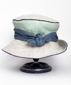 Back view of a mint green and natural 100% linen Zinnia Summer Hat against a white background