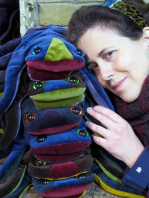 A happy client hugging her 5 stacked velvet frogs made by Gwendolyne