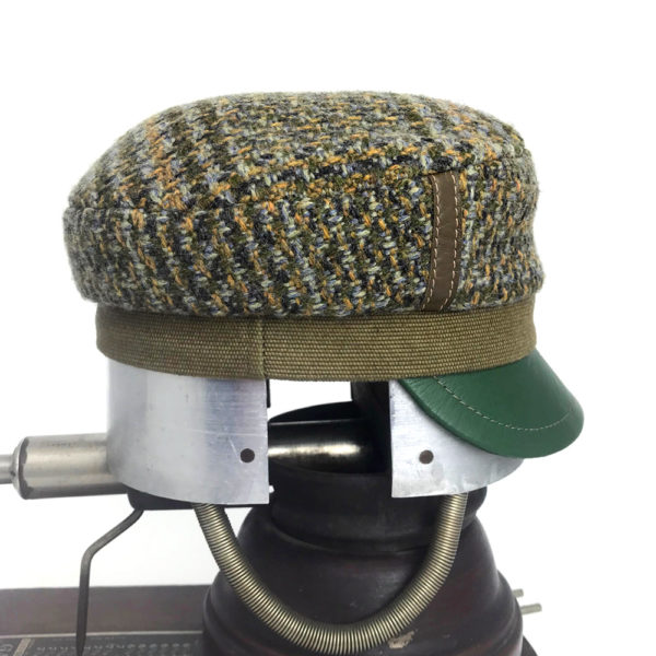Side view of a olive green Abbey Road cap against a white background