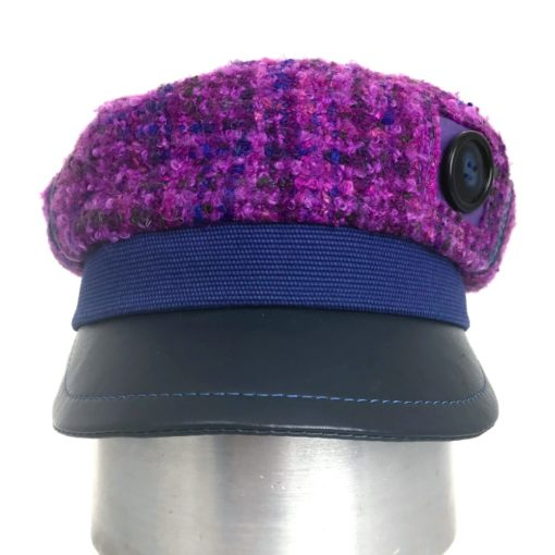 Front view of a purple boucle wool Abbey Road cap against a white background
