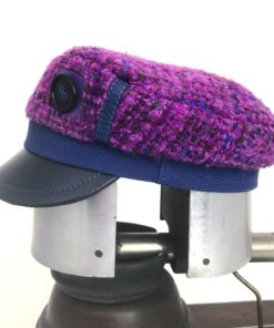Side view of a purple boucle wool Abbey Road cap against a white background