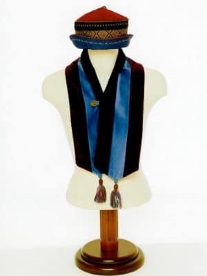 The Baatar cap and velvet tassel scarf is on a display mannequin