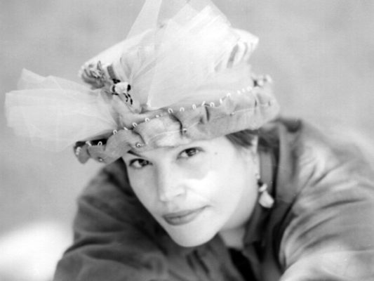 Close up of Gwendolyne Preboy modelling a bee in the bonnet silk hat