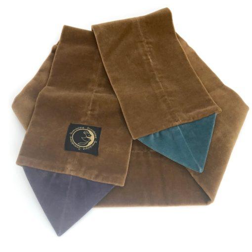 Backside side of the the beige Velvet Triangle Scarf made from 100% cotton velvet against a white background