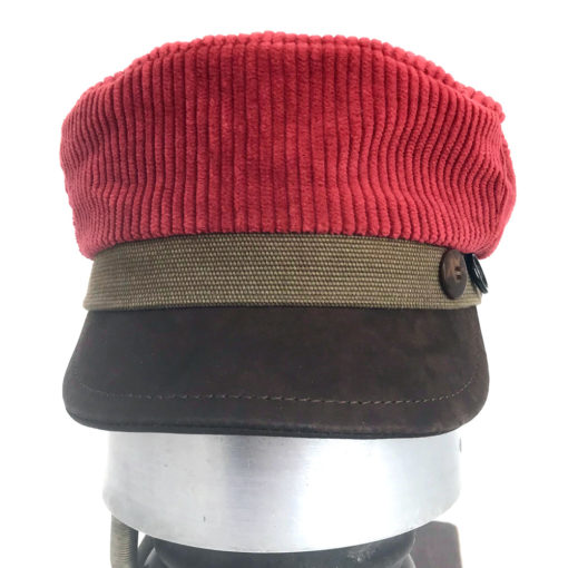 Front view of a red and brown Cordy cap against a white background