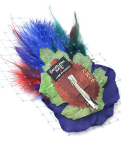 Back side of a dark blue red feather hair clip fascinator against a white background