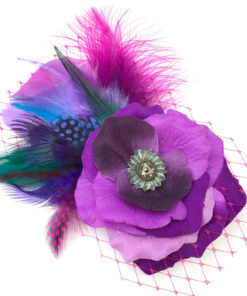 Front side of a fuchsia purple feather hair clip fascinator against a white background