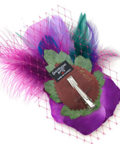 Back side of a fuchsia purple feather hair clip fascinator against a white background