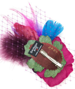 Back side of a violet purple hot pink feather hair clip fascinator against a white background