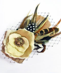 A ivory tan rose and feather hair clip fascinator against a white background