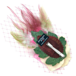 Back side of a pink candy rose feather hair clip fascinator against a white background