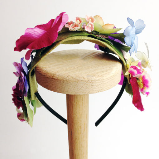 Back view of the Pink Rose Flower girls hairband against a white background