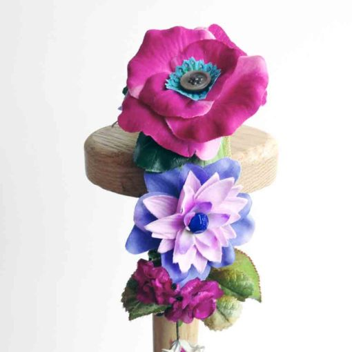 Side view of the Pink Rose Flower girls hairband against a white background