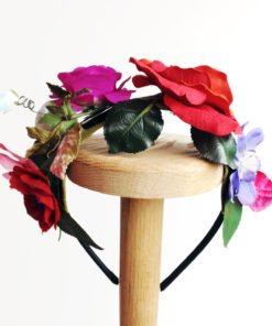 Back view of the Red Rose Flower girls hairband against a white background