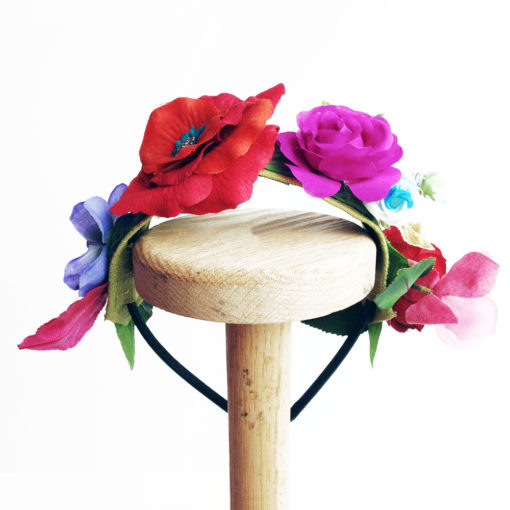 Front view of the Red Rose Flower girls hairband against a white background