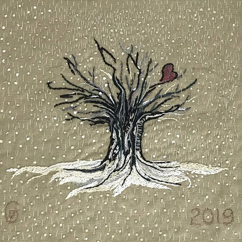 Hand embroidered winter tree with snow falling