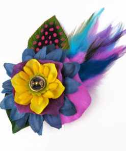 A small yellow hair clip fascinator against a white background