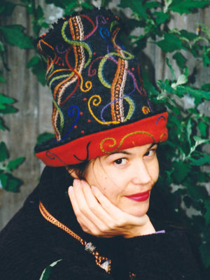 Close up of Gwendolyne Preboy modelling the embroidered Sugar Sack Hat made for the Museum of Textiles Show