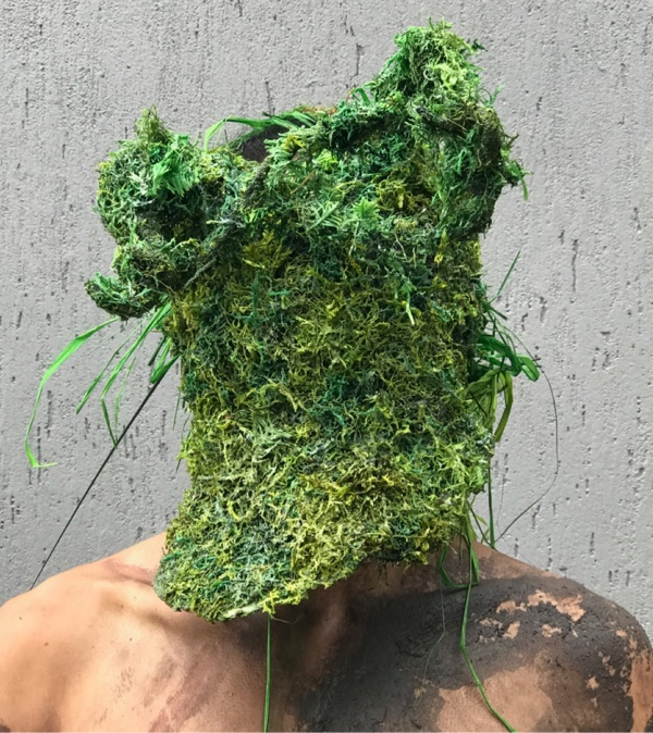 A man wearing a Grass and Moss Mask