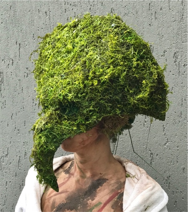 A woman wearing a Grass and Moss Mask