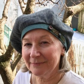 client wearing a Gwendolyne Hat