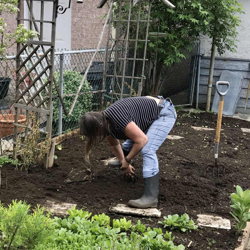 Yvetta planting her seedlings