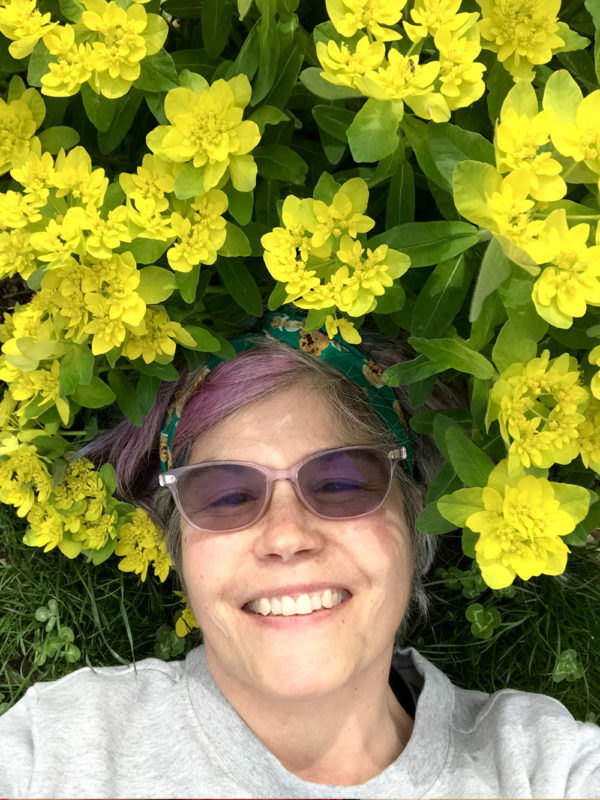 Gwendolyne smiling under a euphoria bloom