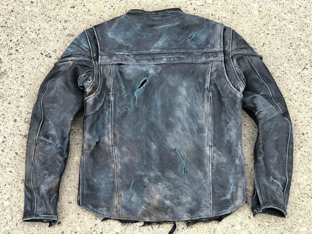 Extreme wear and tear on back of black leather jacket