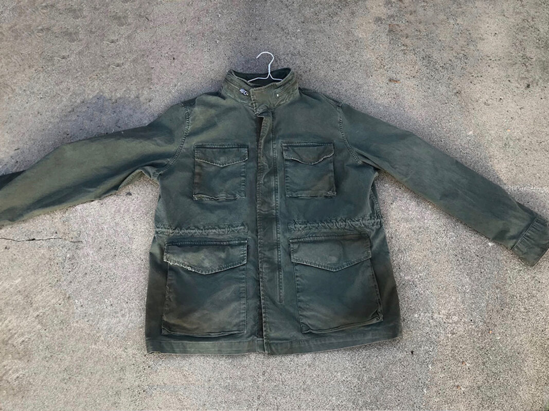 Aged green cotton jacket to be worn several years by young man