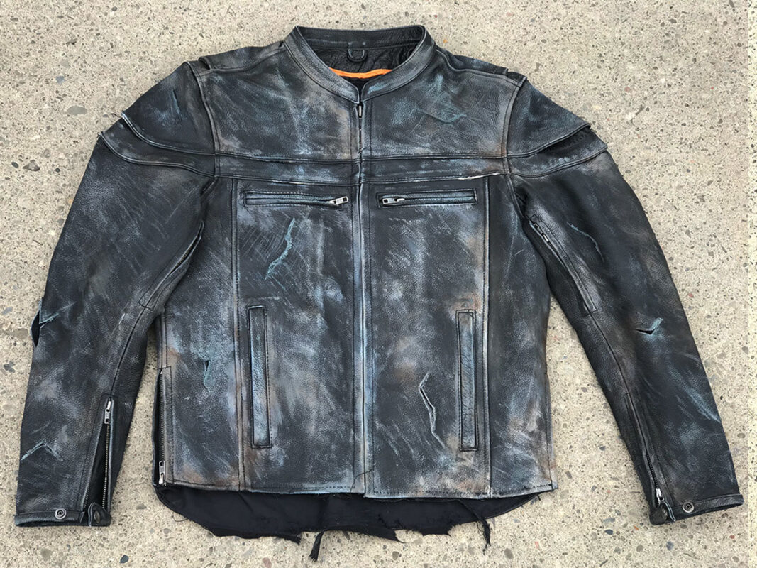 Extreme wear and tear on front of black leather jacket