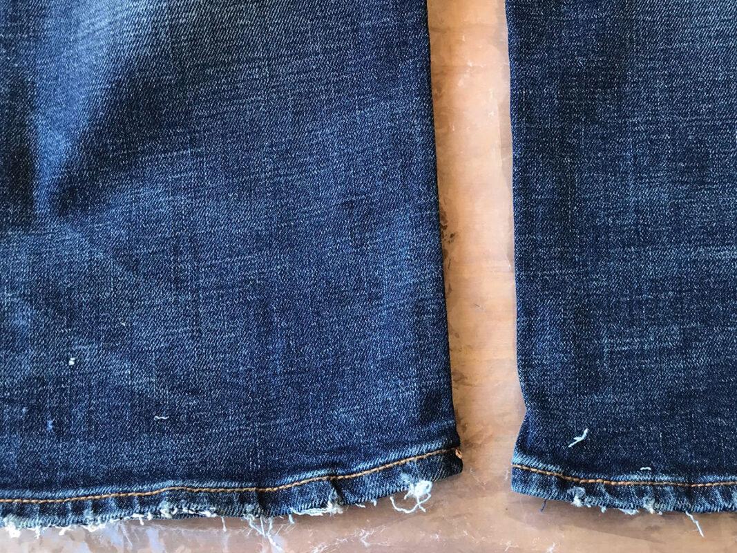 Aged detail of the jean leg bottom hems